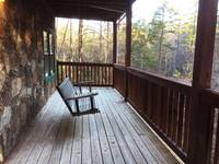Lower Level Porch Area at HIKERS HIDEAWAY CABIN in Wears Valley TN