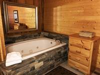 Downstairs Bedroom Whirlpool Tub at HIKERS HIDEAWAY CABIN in Wears Valley TN
