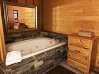 Downstairs Bedroom Whirlpool Tub at HIKERS HIDEAWAY CABIN in Wears Valley TN