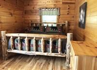 Main Level Bedroom at HIKERS HIDEAWAY CABIN in Wears Valley TN