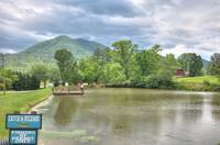 Spend the day fishing in the stocked pond.  Courtesy of Honeysuckle Meadows RV Park. at ALWAYS AND FOREVER in Wears Valley TN