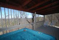 The outdoor hot tub will be one of your favorite spots to visit in the Great Smoky Mountains.   at PEEK-A-VIEW in Wears Valley TN