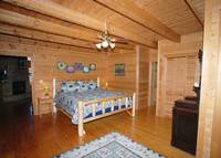 Master Bedroom Located On The Main Level Offers Southern Comfort Relaxation.   at PEEK-A-VIEW in Wears Valley TN