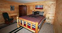 Queen Size Bed Located Downstairs Adjacent To Gameroom.  The Smokies Are Calling You.... at PEEK-A-VIEW in Wears Valley TN